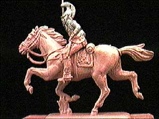 Undercoated horse and rider