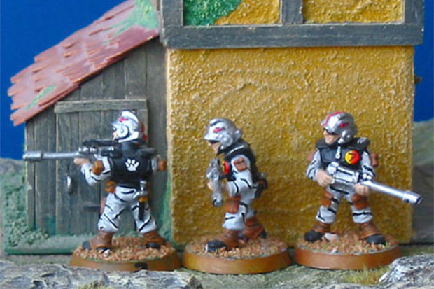 Games Workshop Warhammer 40k Imperial Guard painted in a stripe camouflage pattern